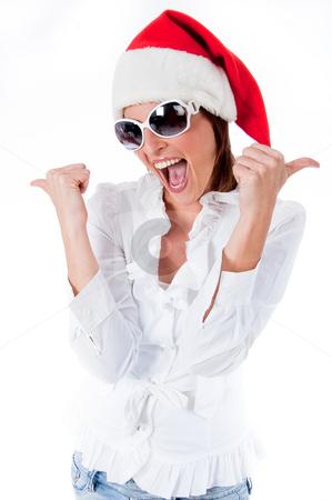 Beautiful young women wearing santa's hat stock photo,  by Get4net