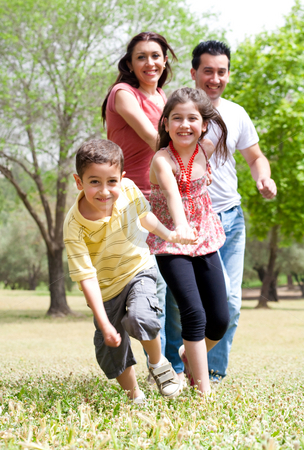 Happy family having fun in the park stock photo, Happy family having fun in the park,outdoor by Get4net