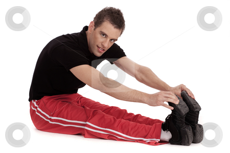 Fitness men stretches his leg stock photo, Fitness men stretches his leg before and exercising over white background by Get4net