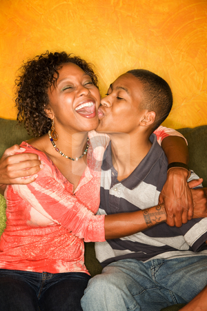 Happy African-American woman and teen boy stock photo, Attractive African-American woman with teen family member by Scott Griessel