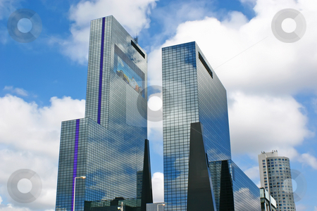 Office buildings stock photo, Contemporary office towers on a blue sky background by Alexander Pastukh