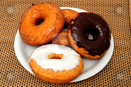 Doughnuts stock photo, Sweet Donuts on a saucer ready for breakfast or a snack by Lynn Bendickson