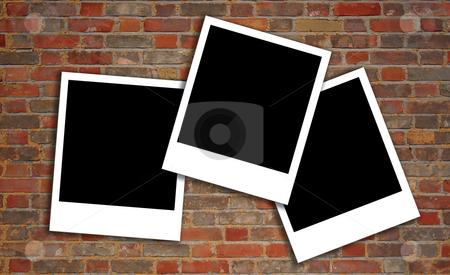 Brick wall texture with polaroids stock photo, Brick wall texture with polaroids by Michiel De Wit