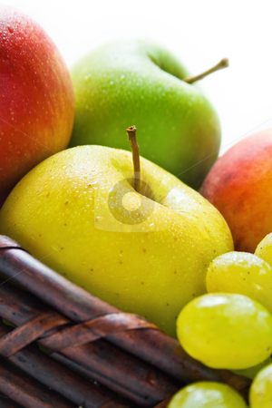 Fruits stock photo, Ffruits close-up placed in a wicker basket isolated on white background by Miroslav Ivanov