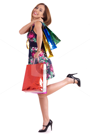 Cute woman enjoyed shopping stock photo, Cute woman enjoyed shopping and carrying her bags in her hand on a white background by Get4net