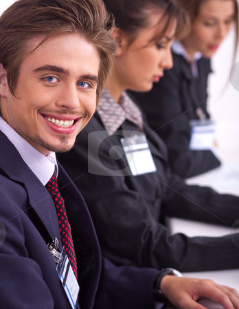 Closeup of attractive business men with colleague stock photo, Closeup of attractive business men with colleague in background by Get4net