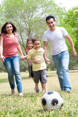 Family  playing soccer and having fun stock photo, Family outdoor playing soccer and having fun by Get4net