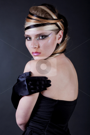 Sexy beautiful makeup artist stock photo, Sexy beautiful makeup artist  looking with her black hand glove over black background by Get4net