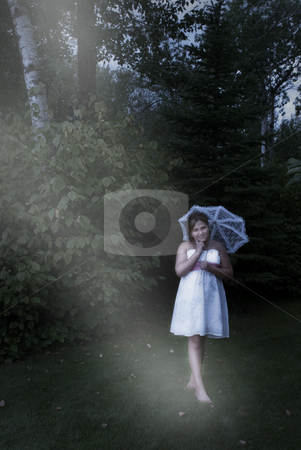 Child Walking At Night stock photo, A young preteen girl is walking outside in a fantasy like environment. by Richard Nelson