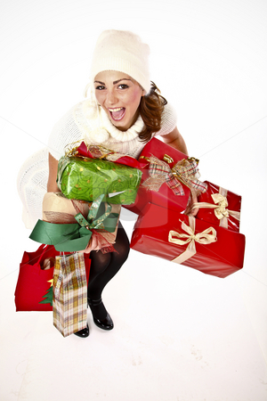 Presents Are Here stock photo, Cute Cheerful Woman Holding A Bunch Of Gifts by Nick Fingerhut