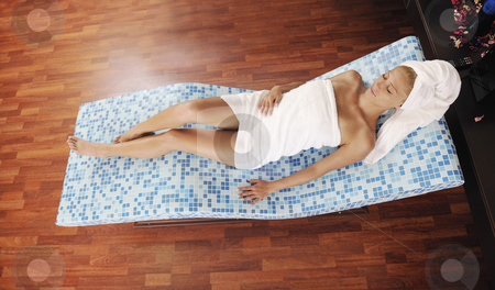 Woman relaxing at spa stock photo, Young beautiful woman relaxing at spa and wellness center at hot bed with blue tiles decoration by Benis Arapovic