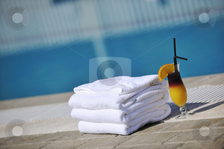 Coctail drink stock photo, Coctail dring with orange att sunny day on swimming pool side with white towel decoraton by Benis Arapovic