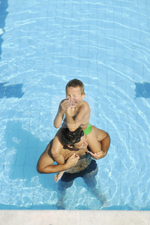 Happy father and son at swimming pool stock photo, Happy father and son have fun at swimming pool by Benis Arapovic