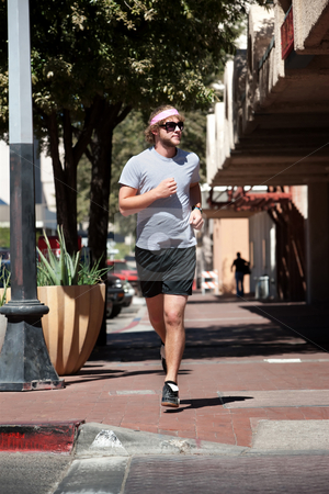 Single, handsome male running stock photo, Single male out for a run in the city. by Scott Griessel