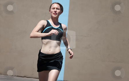 Woman running for fitness and health stock photo, Fit woman runner practicing for race. by Scott Griessel