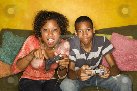 African-American family playing video game stock photo, Good-looking mom and son Playing a Video Game with Handheld Controllers by Scott Griessel