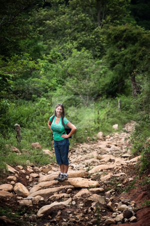 Female hiker on a rugged rustic trail in Costa Rica stock photo, Female hiker on a rugged trail in Costa Rica by Scott Griessel