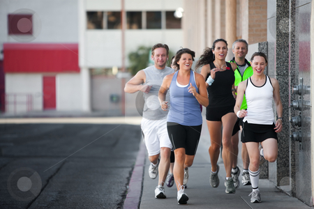 Group of friends runs downtown. stock photo, Men and women running for exercise downtown by Scott Griessel