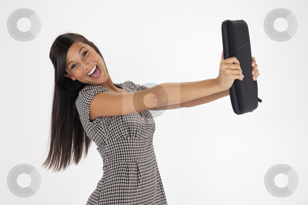 Young Woman Excitedly Holding Out a Laptop Case stock photo, Pretty young Asian woman laughs while holding out a laptop case against a white background. Horizontal shot. by Edward Bock