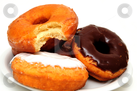 Breakfast Doughnut stock photo, Sweet Donuts on a saucer ready for breakfast or a snack by Lynn Bendickson