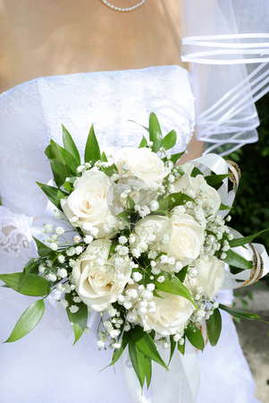 Wedding bouquet stock photo, Beautiful white wedding bouquet in hands of the bride. by Pavel Vorobyov