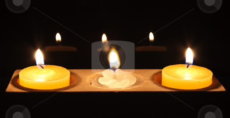 A white flower candle in centre piece stock photo, Two yellow candles with a white flower in the centre by Stephen Clarke