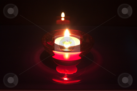 A red candlein candle holder stock photo, A red glass candle holder with a glowing candle by Stephen Clarke
