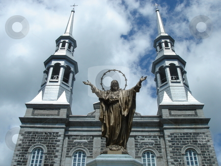 Church and Jesus stock photo, Grey church with a gold statue of Jesus by cloudy weather by Elenarts