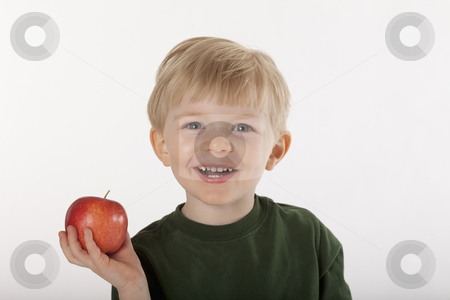 Young Boy Holding an Apple stock photo, Little boy smiles at the camera while holding an apple in one hand. Horizontal shot. by Edward Bock