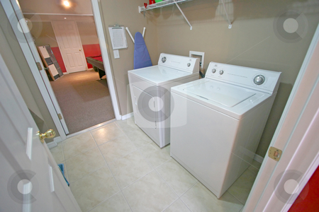 Laundry Room stock photo, An Interior Laundry Room in a Home by Lucy Clark