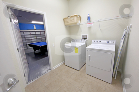 Laundry Room stock photo, An Interior Laundry Room of a Home by Lucy Clark