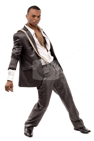 Black fashion man posing at the camera stock photo, Black fashion man posing at the camera on a isolated white background by Get4net