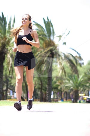 Young woman jogging stock photo, Young cauasian woman jogging in an outdoor by Get4net