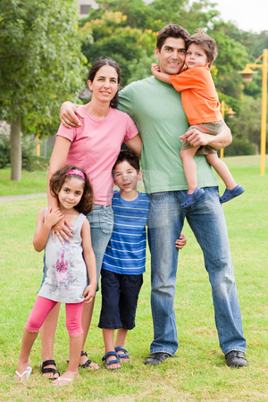 Happy family of five stock photo, Happy family of five standing together in the park, outdoors by Get4net