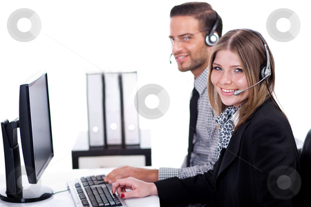 Smiling executive operators  stock photo, Smiling executive operators working together in their office by Get4net