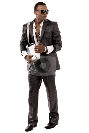 Business executive holding the brief case stock photo, Young business executive holding the brief case on light background by Get4net
