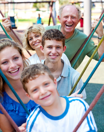Close-up shot of a family  playing in the playground stock photo, Close-up shot of a family  playing in the playground,outdoors by Get4net