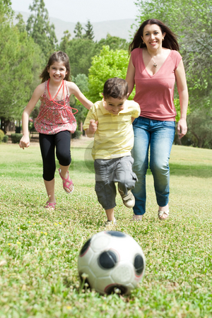 Family playing soccer and having fun stock photo, Family playing soccer and having fun, outdoor at the park by Get4net