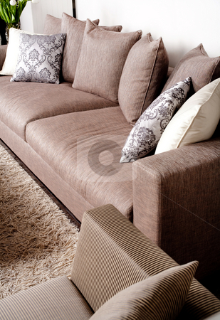 Contemporary sofa in modern setting  stock photo, Contemporary sofa in modern setting with many pillows by Get4net