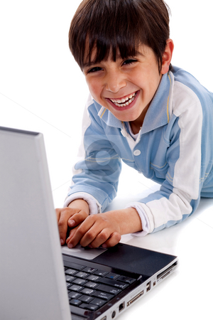 Cute smiling caucasian kid with laptop stock photo, Cute smiling caucasian kid with laptop on isolated white background by Get4net