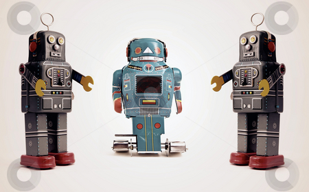 Robot stock photo, Three retro robot toys by Charles Taylor