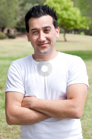 Casual portrait of young men with his hands folded stock photo, Casual portrait of young men with his hands folded in the park, outdoor by Get4net