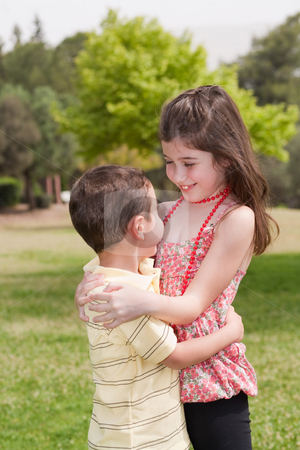 Brother and sister affectionatly hugging stock photo, Brother and sister affectionatly hugging in the park, outdoor by Get4net
