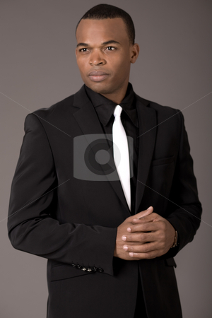 Portrait of confident african american business man stock photo, Portrait of confident african american business man on a grey background by Get4net