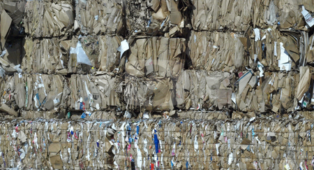 Stacked and ready stock photo, Stacks of brown cardboard boxes crushed and ready for recycling by Tim Markley