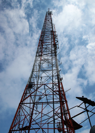 Communications tower stock photo, Tall communications tower against a blue sky by Tim Markley