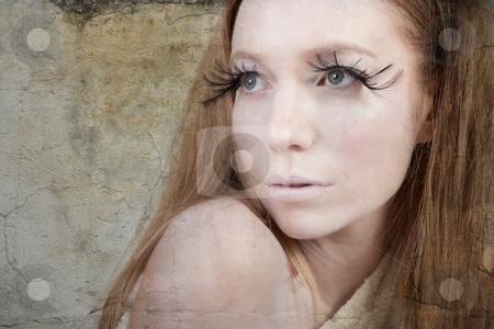 Exotic Looking Fashion Model with Long Eyelashes stock photo, A glamorous, high fashion woman with fake eyelashes poses for camera. Isolated. Horizontal shot. by Angela Hawkey
