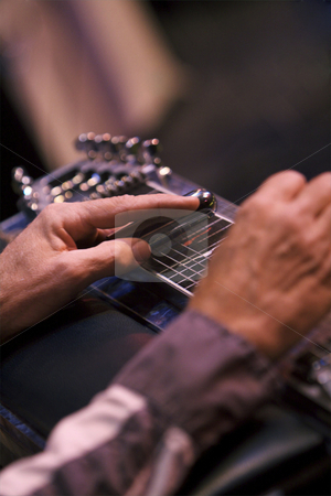 Pedal Steel stock photo, Country Western musician playing a pedal steel guitar by Joe Hubbard