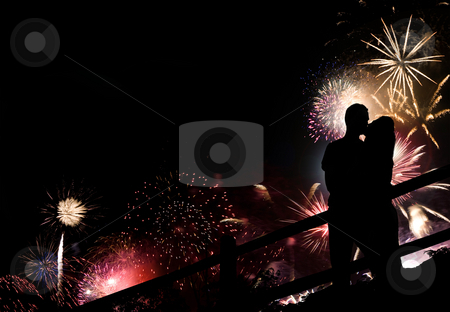 Fireworks Couple Silhouette stock photo, A silhouette of a kissing couple in front of a huge fireworks display. by Todd Arena