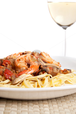 Shrimp Scampi with Linguine stock photo, A delicious shrimp scampi over linguine dish along with a glass of pinot grigio white wine. by Todd Arena